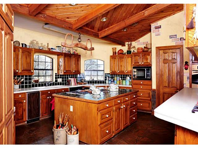 This kitchen has plenty of room for the cooks and guests with a