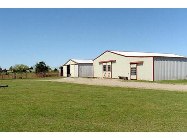The 8 stall barn in the front and the hay/storage barn in the ba