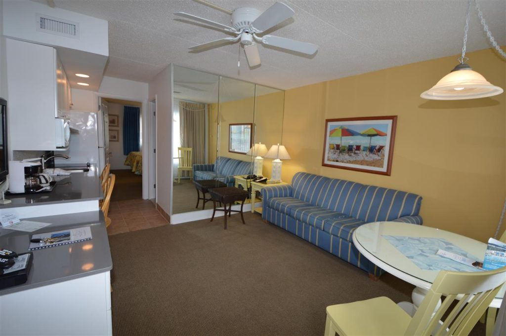 Concord Suites 490 square feet with living room and kitchenette with a bath and bedroom in the back