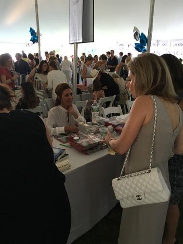 Janelle Friedman signing books