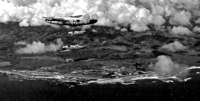 B-24 Escorting 2 Culver PQ-14s, with Kahuku runways below
