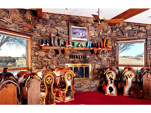 How about this living area with wood burning fireplace and room