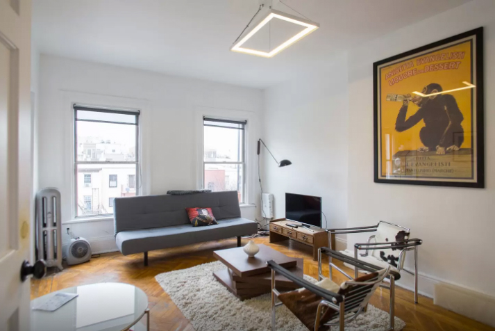 This sweet one-bedroom penthouse apartment in Williamsburg will be illegal to list via Airbnb of the new law passes. (photo via Airbnb)