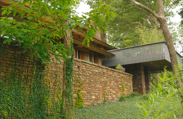 The Buckley House, designed by E. Fay Jones, is a midcentury modern with all the requisite large windows and light.