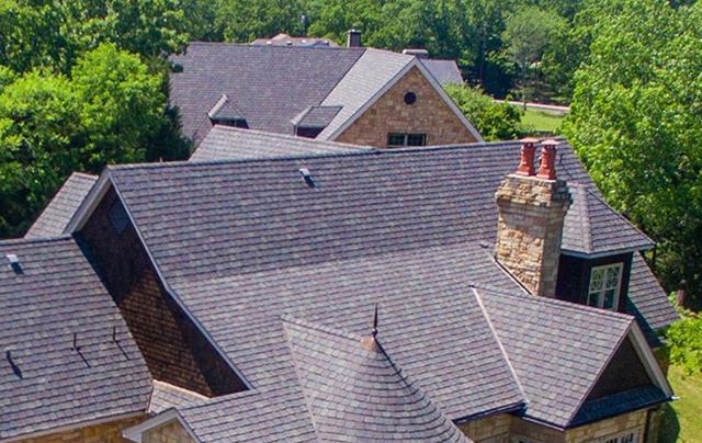 European-inspired roof detailing lends the lake home an authentic feel. to the lake home.